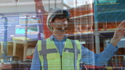 Futuristic Architectural Engineer Wearing Augmented Reality Headset, Uses Gestures to Create 3D Graphics VFX Model of a Building with Infographics. In Background Construction Site in Progress