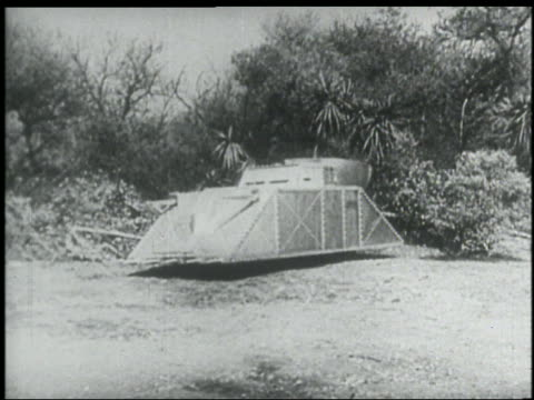 "B/W 1936 PAN futuristic armored ""tank"" drives away in grass"