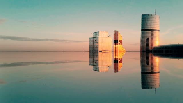 vídeos de stock e filmes b-roll de futuristic city aerial background. mirror effect - efeitos especiais