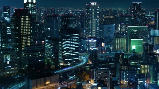futuristic city at night, aerial timelapse - 大阪駅点の映像素材/bロール