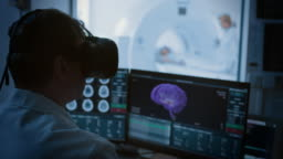 Futuristic Concept: In Medical Control Room Doctor Wearing Virtual Reality Headset Monitors Patient Undergoing MRI or CT Scan Procedure. Computer Displays Show 3D Brain Model with Possible Cancer.