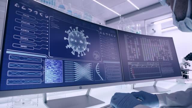 futuristic laboratory equipment - coronavirus testing. side view of scientist - biomedical illustration stock videos & royalty-free footage