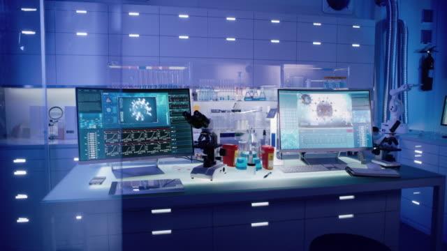 futuristic laboratory equipment - coronavirus testing - man and machine stock videos & royalty-free footage
