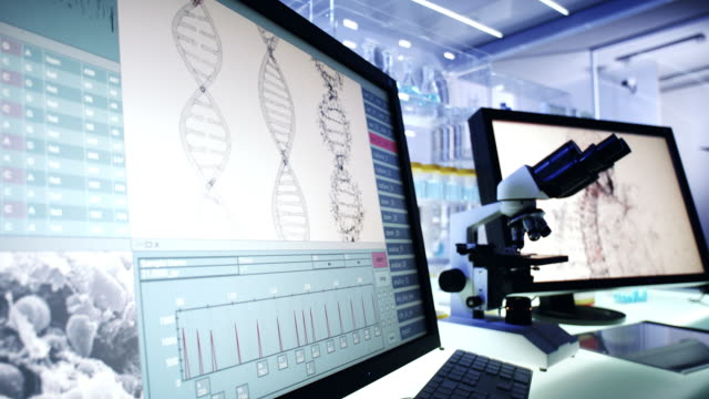futuristic laboratory equipment. dna research on computer screens - helix model stock videos & royalty-free footage