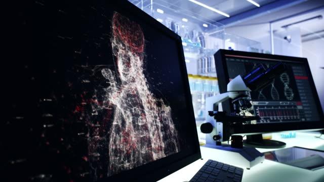 futuristic laboratory. human exoskeleton project - exoskeleton stock videos & royalty-free footage