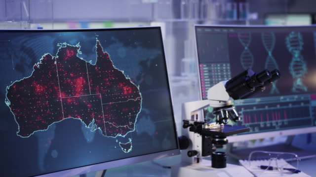 futuristic laboratory. virus spreading level on australia map. scanning dna mutations - biomedical illustration stock videos & royalty-free footage
