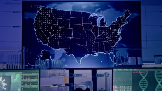 futuristic laboratory. virus spreading level on usa map. first infections - biomedical illustration stock videos & royalty-free footage