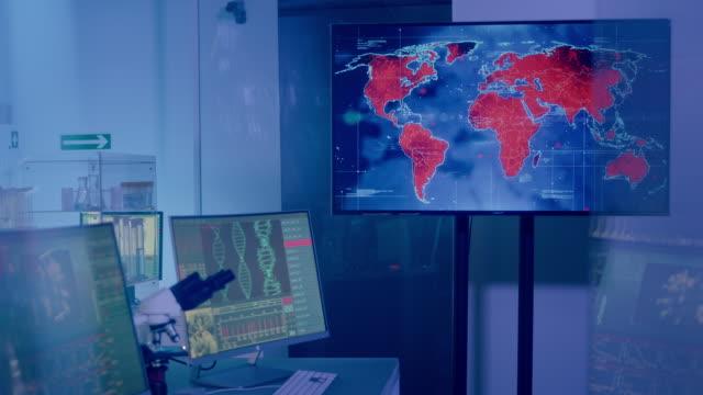 futuristic laboratory. virus spreading level on world map. medium infectivity - biomedical illustration stock videos & royalty-free footage