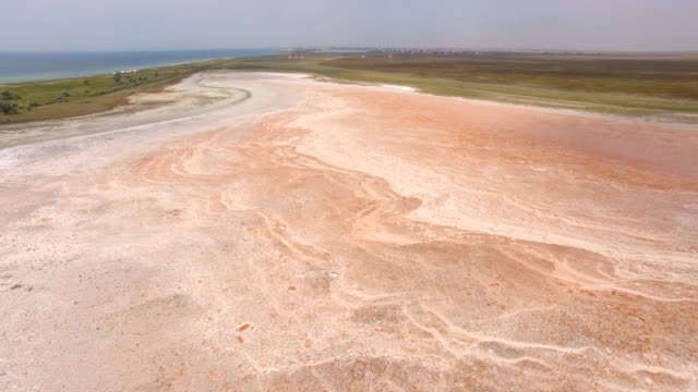 aerial: futuristic landscape of red salt lake - backwater stock videos & royalty-free footage