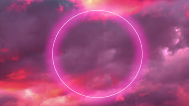 futuristic neon circle glowing in the burning sky with stunning pink colors. - eternity stock videos & royalty-free footage