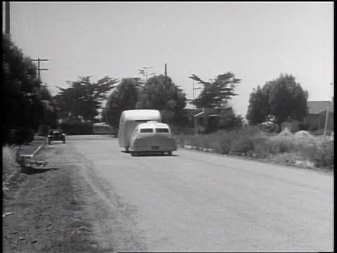 stockvideo's en b-roll-footage met b/w 1935 futuristic streamlined car + trailer driving on road toward camera / guadalupe, ca - 1935