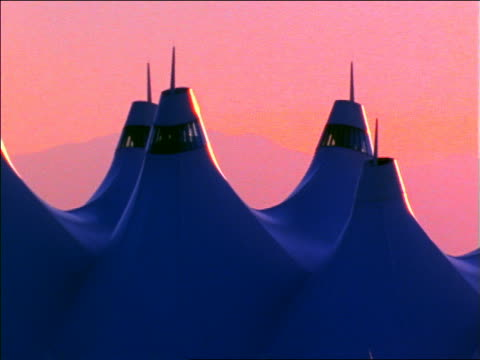 stockvideo's en b-roll-footage met futuristic tent-like roof of airport building at sunset / denver, colorado - dia