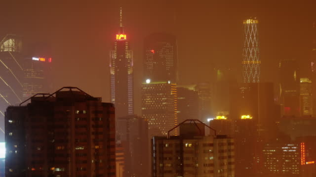 futuristic time lapse of guangzhou skyline at night. medium wide shot - spoonfilm stock-videos und b-roll-filmmaterial