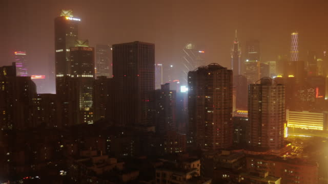 ws futuristic time lapse of guangzhou skyline at night. - spoonfilm stock-videos und b-roll-filmmaterial