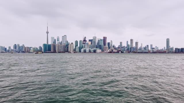 futuristic toronto skyline from lake ontario - lakeshore stock videos & royalty-free footage