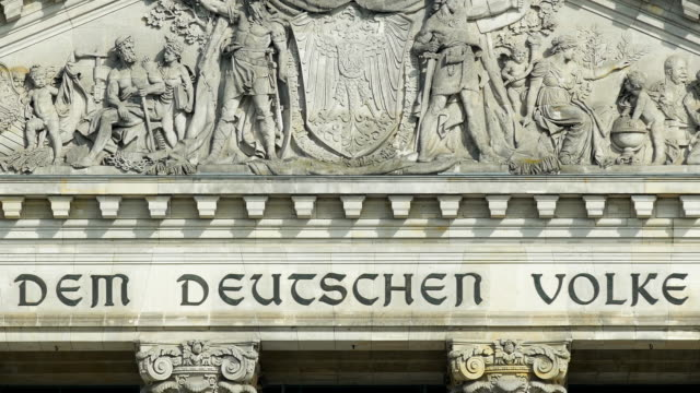 tu gable of the berlin reichstag building (4k/uhd to hd) - architrav stock-videos und b-roll-filmmaterial