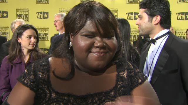 Gabourey 'Gabby' Sidibe on who she's wearing meeting Zac Efron how she's handling award season so far what she attributes the film's success to who...