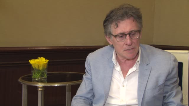 gabriel byrne on the atmosphere in cannes at 'louder than bombs' interview on may 19, 2015 in cannes, france. - 2015 stock-videos und b-roll-filmmaterial
