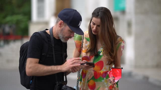 gabriela dias wears a floral print dress a green chanel bag outside andrew gn during paris fashion week womenswear spring/summer 2018 on september 29... - floral pattern stock videos & royalty-free footage