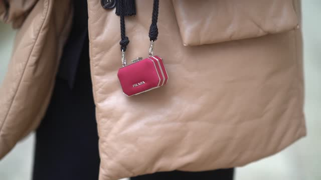 gabriella berdugo wears a beige leather puffer oversized coat, a prada mini red box bag, january 13, 2021 in paris, france. - large stock videos & royalty-free footage