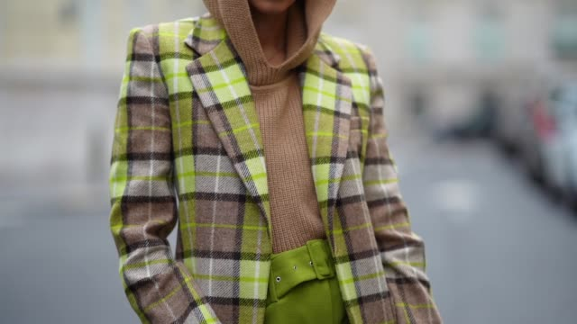 gabriella berdugo wears a green and beige checked blazer with beige hoodie knit jumper and green high waisted palazzo pants with belt printed... - waist stock videos & royalty-free footage