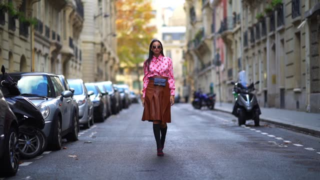 gabriella berdugo wears a preppy pink shirt with printed strawberry details, a midi pleated / gathered leather brown skirt from manoush, black long... - smart casual stock videos & royalty-free footage