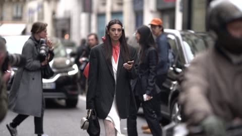 gabriella berdugo wears a striped blazer jacket, an orange scarf, a chloe bag, gucci tights, white shoes, outside thom browne, during paris fashion... - tights stock videos & royalty-free footage