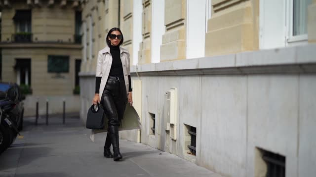 gabriella berdugo wears a total look from barbara bui, black leather trousers with maxi pockets, black turtleneck knit pullover, black high soldier... - sleeve stock videos & royalty-free footage