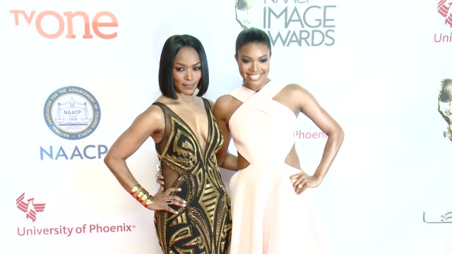 gabrielle union and angela bassett at the 46th annual naacp image awards arrivals at pasadena civic auditorium on february 06 2015 in pasadena... - パサディナ公会堂点の映像素材/bロール