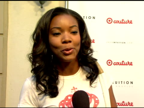 gabrielle union on her target couture shirt on why target is so great on shopping at intuition at the launch the target couture collection by... - jaye hersh stock videos and b-roll footage