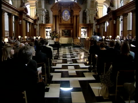 gaby rado memorial service; evening news: u'lay england: london: st bride's church: int bv congregation at memorial service for gaby rado jim grey ,... - itv evening news stock-videos und b-roll-filmmaterial