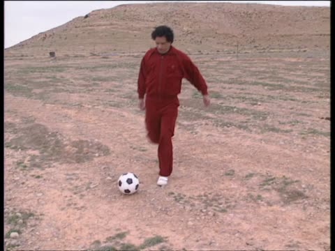 gaddafi kicks a soccer ball around with members of his entourage and family including his son saadi and daughter hana hana gaddafi was allegedly the... - muammar gaddafi stock videos & royalty-free footage