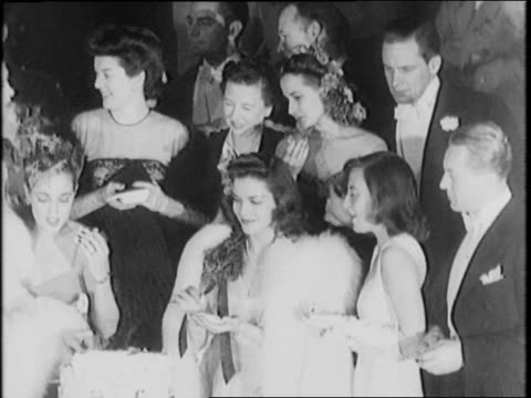 gala birthday party for president roosevelt / view of event hall with a large group of people dancing / bag of balloons hangs from ceiling of... - cheek to cheek stock videos & royalty-free footage