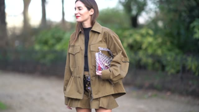 Gala Gonzalez wears a khaki jacket a skirt a bag outside Valentino during Paris Fashion Week Womenswear Fall/Winter 2018/2019 on March 4 2018 in...