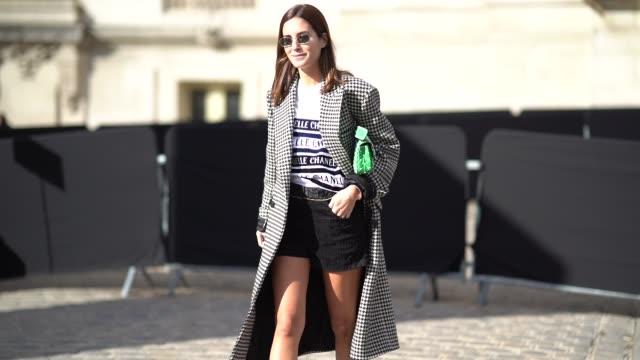 Gala Gonzalez wears wears agreen bag outside Chanel during Paris Fashion Week Womenswear Spring/Summer 2018 on October 3 2017 in Paris France