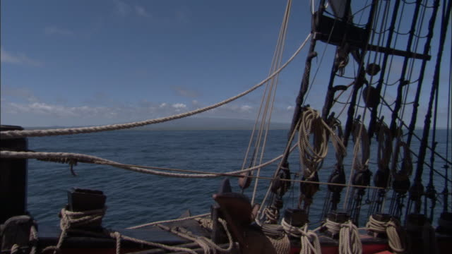 galapagos islands seen through rigging of replica of hms endeavour. - rigging stock videos & royalty-free footage