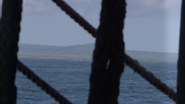 galapagos islands seen through rigging of replica of hms endeavour. - anchored stock videos & royalty-free footage