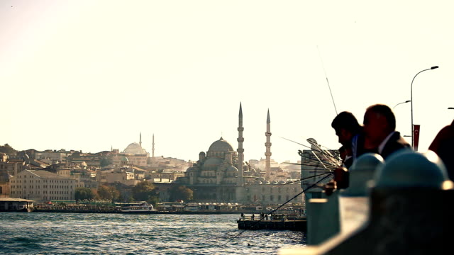 hd: galata bridge & fishermen - yeni cami mosque stock videos and b-roll footage