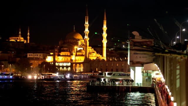 hd: galata bridge and new mosque - yeni cami mosque stock videos & royalty-free footage