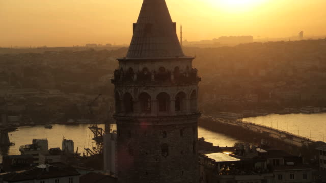 galata tower at sunset - golden horn istanbul stock videos and b-roll footage
