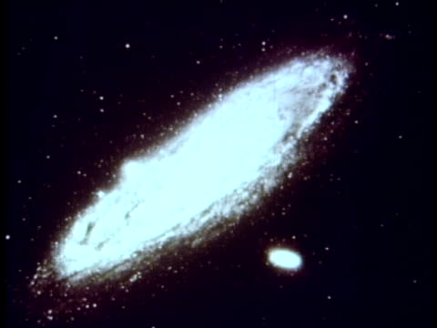 1959 b/w montage galaxies with narrative (edwin hubble)  / audio - 1950 1959 stock-videos und b-roll-filmmaterial