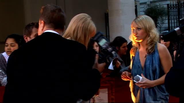 galaxy british book awards 2009; gvs liz mcclarnon signing autographs, conducting interviews and posing for photocall on red carpe - リズ・マクラーノン点の映像素材/bロール