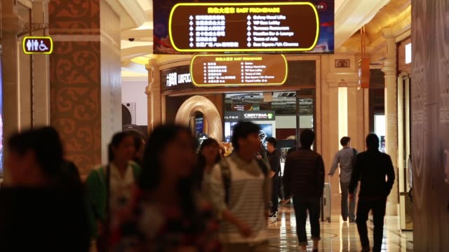galaxy macau casino resort boundary tapes stand near the shuttle bus service collection point in macau, china, on monday, mar 16 passengers wait in... - macao stock videos & royalty-free footage