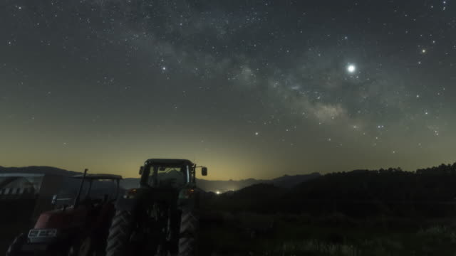 galaxy rising with the tractors - agricultural machinery stock videos & royalty-free footage