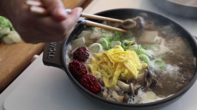 'galbitang' (korean style short rib soup) simmering - ingredient stock videos & royalty-free footage