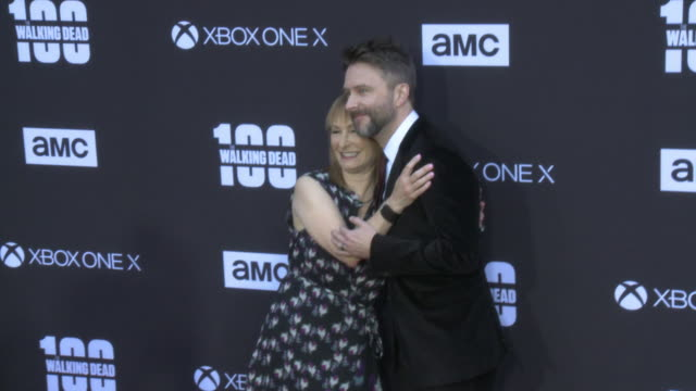 Gale Anne Hurd and Chris Hardwick at the AMC's The Walking Dead 100th Episode Season 8 Special Premiere Screening at The Greek Theatre on October 22...