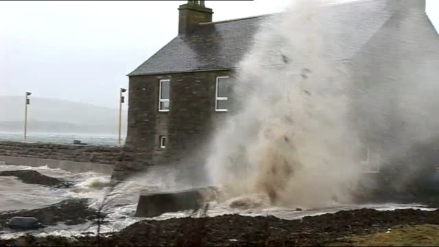 gale force winds and rain in scotland scotland orkney ext sea crashing against house at coast waves crashing over sea wall - gale stock videos and b-roll footage