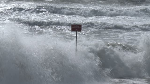 Gale force winds generate very rough surf and high waves that batter the coastline at Rockaway Beach in New York City