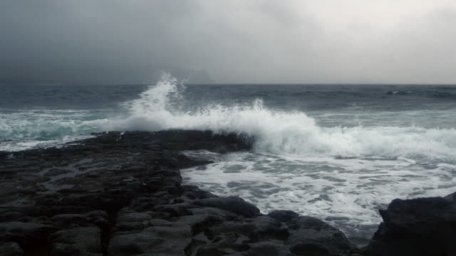 gale waves breaking at the shore near doolin harbour - doolin stock videos & royalty-free footage