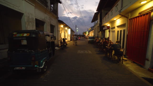 galle fort street, dutch colonial town at sunset. walking with steadicam shot - colonial stock-videos und b-roll-filmmaterial